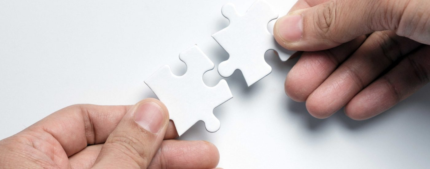 partnership-concept-with-hands-putting-puzzle-piec-HWYKNQR-ConvertImage (1)